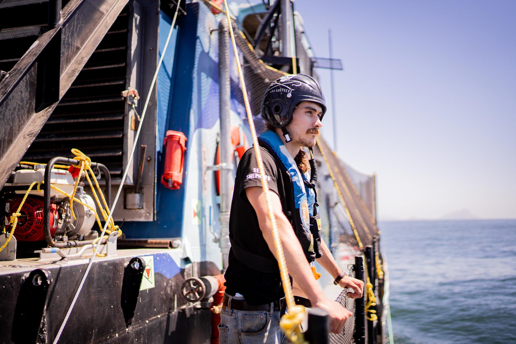 sea-shepherd-deckhand-looking-at-ocean SEA SHEPHERD